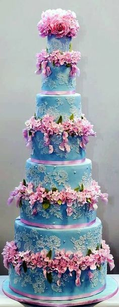 blue wedding cake with pink blooms