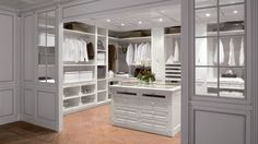 Closet and Wardrobe Designs. Beautiful white and classic walk-in closet with amazing wooden center table with drawer unit, nice shelvings and tall hanging. Fancy Dream Home Interior Walk-in Closet Designs