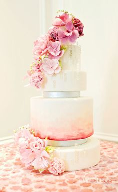 This cake is sweet (probably literally sweet too), would be really pretty with yellow and purple accent flowers too