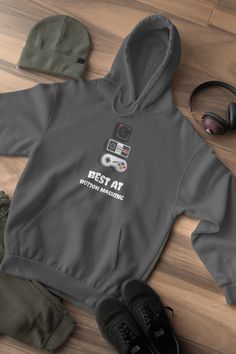 Best At Button Mashing This design will add some fun to your wardrobe or it might make the perfect gift! Gaming Apparel, Buttons, Gift, How To Make, Fun, Jackets, Design, Fashion, Down Jackets