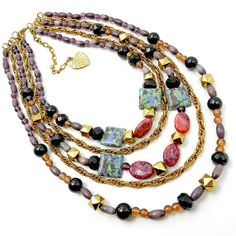 Beaded mutistrand necklace layered in purple black gold