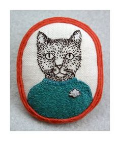 Cat brooch by Poncho.  Would a 10yo wear a brooch? Ethan would just love this!