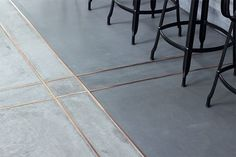 (Image credit: Momoko Kudo Architects) This concrete floor (in a Paris restaurant by Momoko Kudo Architects) gets an extra bit of shine from brass inlays. Raw Beauty: 14 Gorgeous Spaces with Concrete Floors Decoration Inspiration, Interior Inspiration, Floor Design, Tile Design, Design Design, Classic Decor, Floor Ceiling, Concrete Floors, Stained Concrete