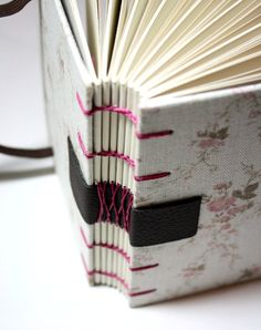 nice combination of pink and black - french sewing on a tape, coptic stitch too #bookbinding