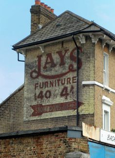 ghost sign for Jay's Furniture