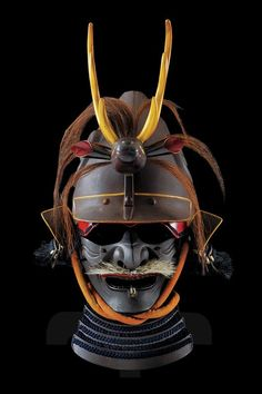Kawari kabuto with menpo and maedate, dating: early 19th Century. Leather hachi, worked with two big spiral grooves on the sides, sabinuri lacquering , iron mabizashi and fukigaeshi lacquered en suite with relived and gilded borders; wooden maedate lacquered in brown, gold and red in the shape of a deer's head with long horsehair; cloth-lined inside. Two-piece iron menpo lacquered in brown on the outside and red on the inside, four-blade yodarekake fastened with blue silk.