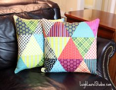 Pretty Patchwork Pillows. I wouldn't have thought to put these designs together, but I like it!