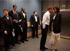 President Barack Obama and First Lady Michelle Obama share a private moment in a freight elevator at an Inaugural Ball in Washington, DC, on January 20, 2009.