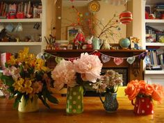 gorgeous mixed arrangements in colourful jugs