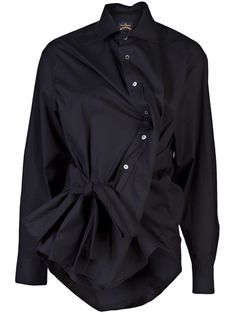 Squad shirt in black from Vivienne Westwood Anglomania. This cotton stretch wrap blouse features a collar with front button down placket, long sleeves with button cuffs, tow waist ties, and long curved back hem.