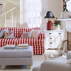 Red, White, and Blue Touches.              Combining rosy-red gingham, cool blue mattress-ticking, and crisp white walls, the living room exudes all-American country appeal. Chicken-topped ceramic canisters and a lamp fashioned from an old cream pail keep the look full of surprises.