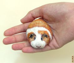 Hand painted rock. Guinea pig 7. flickr.com