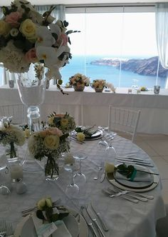 Wedding table setting with a view to Oia village. Santorini Weddings, Wedding venue, Wedding ceremony and reception, Sunset view.