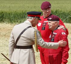 Hero: The Prince of Wales meets 89 year old Jock Hutton after he completed a tandem parachute jump with the red devils. He risked his life when he dropped onto the Normandy beaches 70 years ago