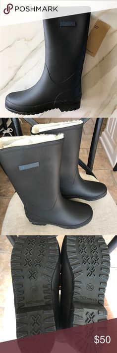 "Tretorn Kelly Vinter Rubber Boots Rubber upper, designer logo at side, faux fur lining, man-made sole. Measurements: Heel height 1"", platform sole ½"", shaft height 13"", calf circumference 3"".  Original shoe box is included. Tretorn Shoes Winter & Rain Boots"