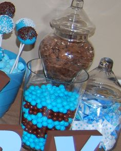 Baby shower boy- great treats in brown and blue. Sixlets, cake pops, mints, almonds etc.,