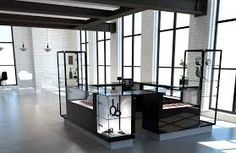 Imagic Glass is a specialty supplier of custom architectural glass. UV Bonded frameless glass fixtures or showcases in choice of glass, edgework and finish.  #imagicglass #uvbondedglass