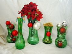 An instant collection of vintage emerald green vases. They would be gorgeous in a window where they can sparkle from the sunlight.