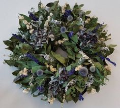 Subtle color variations of hydrangea petals and fanciful echinops blooms intermingle beautifully with rich green salal leaves on this artisanal wreath. Carefully cultivated in California, this dried wreath is a natural accent in any room, and make… Wreath Hanger, Diy Wreath, Wreath Ideas, Door Wreaths, Rustic Wreaths, Frame Wreath, Grapevine Wreath, Hydrangea Wreath, Floral Wreath