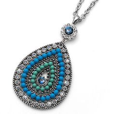 "Stunning Multi Bead Pendant made of rhodium plated metal. The first part of the Pendant is a sparking blue Swarovski Crystal that measures a little less then .5"" and is surrounded by 12 smaller Clear Crystals."