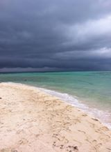 Stormy skies off of Ranguana Caye caught by a guest. There is nothing like watching a storm roll in when you are on a speck of land in the middle of the sea!