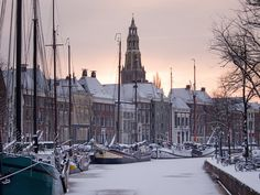 Early Morning Sunrise    Historic ships are moored along the Hoge and Lage der A quays in Groningen, The Netherlands.