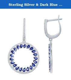 Sterling Silver & Dark Blue CZ Open Circle Earrings. These sparkling sterling silver earrings feature a pave white cz open circle surrounding a ring of small dark blue cz stones. Drops from an oval shaped sterling silver huggie with pave accents. On sterling silver posts. Rhodium plated to prevent tarnish. Product Dimensions: just over 7/8-inch diameter drop, 1-1/2 inches total length.