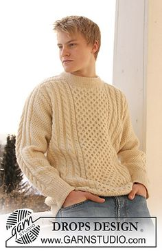 Free pattern for classic saddle shouldered, crew neck, cabled sweater for men.
