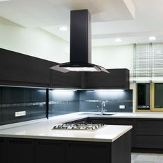 Island Cooker Hood in a stunning black finish. A stylish and popular curved glass island hood available in Stainless Steel, Black, Red, Cream, White and Pink. This Island hood is a sleek and stunning design and very simple to use w Island Extractor Fan, Kitchen Extractor, Extractor Hood, Extractor Fans, Island Cooker Hoods, Island Hood, Range Cooker, Kitchen Hoods, New Kitchen