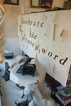 """""""Celebrate the Printed Word"""". Covered everything in copies of book pages. Burke's Book Store, Memphis, TN."""