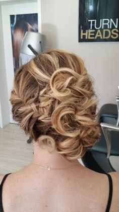 Criss cross plaits with loose curly bunn