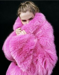 pink fur coats on a cold day whilst walking the poodles.