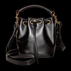 Saint Laurent by Hedi Slimane medium bucket bag, $1,950 similar style available at Saint Laurent