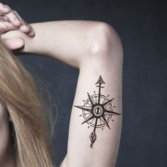 Compass Tattoo with Arrow on Bicep