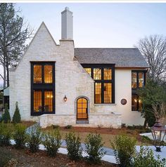 Modern Farmhouse house exterior ideas with white brick. Love the lines of the front roof and how it intersects with the main roof line. Curb appeal ideas, house exterior inspo, white houses with gray roofs Future House, My House, Tudor House, Tudor Cottage, Cottage House, Cottage Style, English Cottage Exterior, English Tudor Homes, Grand House