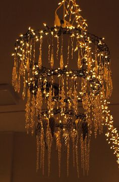 This would be an easy chandelier to make out of christmas ornaments large chandelier made by wiring wreath forms together in graduating sizes winding them with miniature aloadofball Image collections