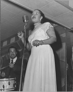 Billie Holiday /singer [at microphone onstage : photoprint, ca. 1940s], Scurlock Studio (Washington, D.C.)