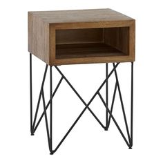 Shop Dixon Side Table.   Constructed of suar wood, the side table offers an open cubby top for stashing books or room essentials.  In pleasing contrast to warm look of natural wood, iron tubing crisscrosses a dark, geometric base.