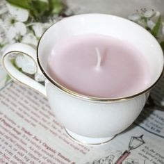 Little candles made by pouring hot wax into vintage teacups. So sweet and cheap!