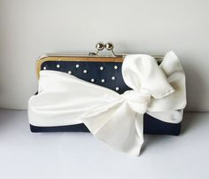 navy clutch with white polka dot beads and white bow perfect for a summer wedding