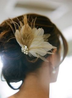 Beautiful feather fascinator in an updo (Photo by Q Weddings)