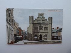 The Talbot (sign visible beyond Babies Castle on the left, advertising King & Sons Entire), Market Square, Horsham.  Cramp's Temperance Hotel is beyond.  The Bear, which still exists, is on the right.