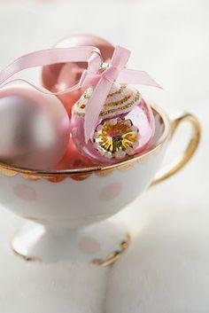 so pretty. pink christmas ornaments in a pretty tea cup