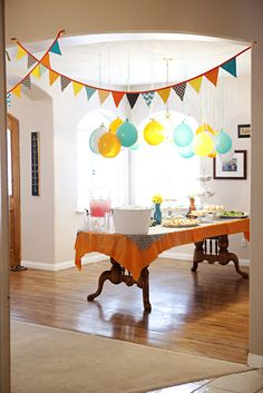 Instead of paying all that money for helium, blow the balloons up yourself and tie the ends to a string.