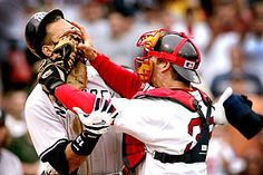 Jason Varitek confronts the Yankees' Alex Rodriguez, shoving his mitt in his face, to set off a brawl before Bill Mueller's walk-off home run off Mariano Rivera gave the Sox an 11-10 comeback win that is seen as a flashpoint in the World Series season