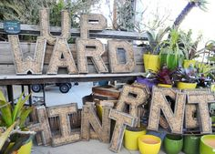 $74 wire letter frames. I'm thinking spell out FARM and mount to that side of the house