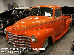 '52 Chevy Pick up Truck.  No other car can pull off the Orange.