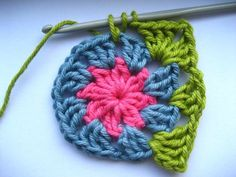 Flower center (bobble stitch) granny square. Easy to follow tutorial includes link to video showing bobble stitch, although clearly written instructions are provided.