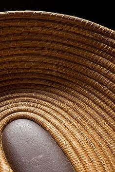 """""""Snake River Stone Basket"""" by Valerie Seaberg, Long Leaf Pine needles coiled with waxed thread."""