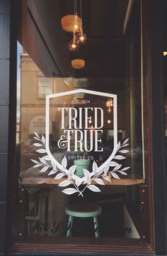 "Tried & True Coffee Co. | This sign really gives off the ""cozy coffee shop vibe"" by using graphical elements that you would see in an older coffee shop. The ""Since 2014"" and branches really tie in the whole look."